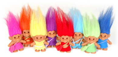 A group of multicolored troll toys.